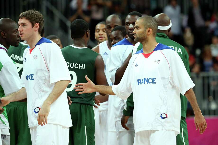 LONDON, ENGLAND - AUGUST 06:  Tony Parker #9 (R) of France is congratulated by players from Nigeria after France won 79-73 during the Men's Basketball Preliminary Round match on Day 10 of the London 2012 Olympic Games at the Basketball Arena on August 6, 2012  in London, England. Photo: Christian Petersen, Getty Images / 2012 Getty Images