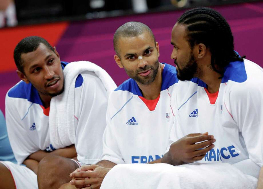 France's Boris Diaw, left, Tony Parker, center, and Ronny Turiaf, right, chat on the bench during a preliminary men's basketball game against Nigeria at the 2012 Summer Olympics, Monday, Aug. 6, 2012, in London. (AP Photo/Eric Gay) Photo: Eric Gay, Associated Press / AP