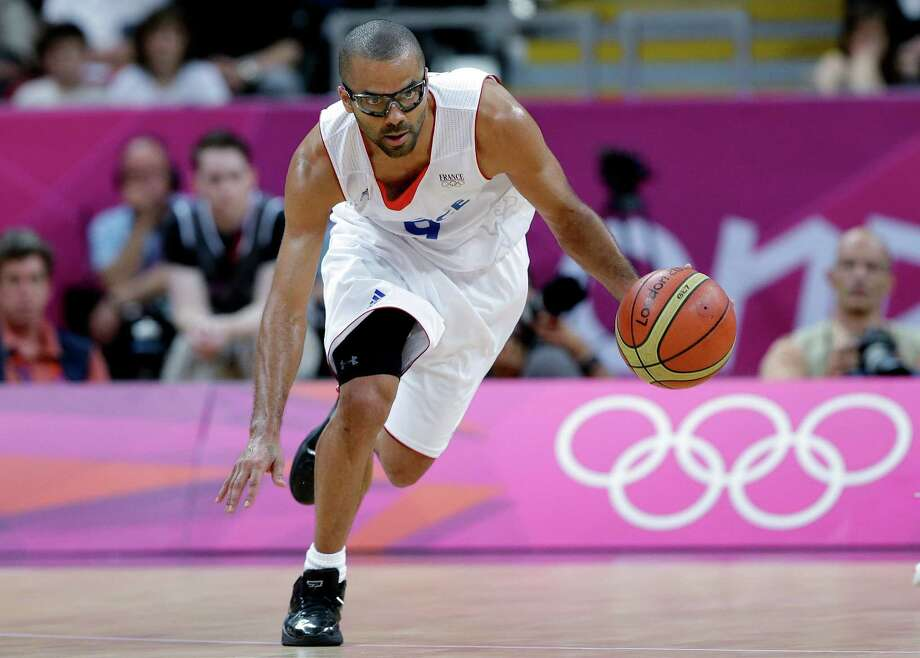 France's Tony Parker moves the ball up court during a preliminary men's basketball game against Nigeria at the 2012 Summer Olympics, Monday, Aug. 6, 2012, in London. (AP Photo/Eric Gay) Photo: Eric Gay, Associated Press / AP