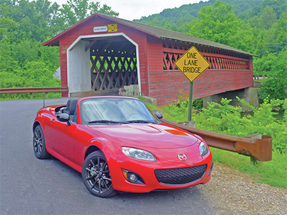 "Mazda MX-5 MiataWhat Forbes said: ""This diminutive low-slung roadster continues to deliver lively acceleration and entertaining go-kart-like handling prowess.""Source: Forbes / copyright: Dan Lyons - 2012"