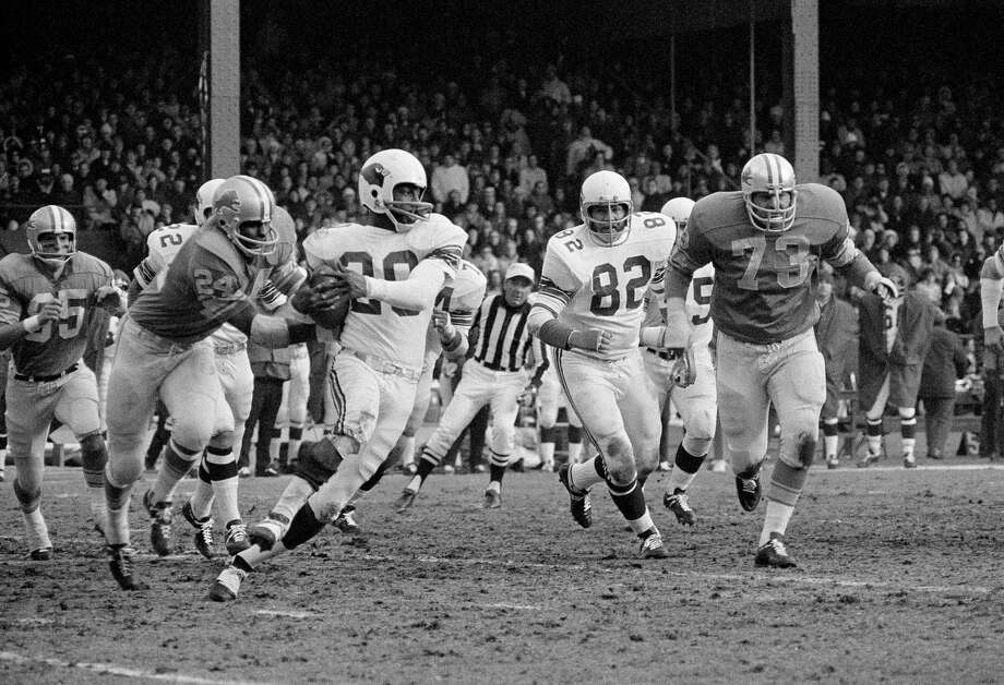 Miller Farr, 20, with the Cardinals looks for running room after he intercepted a Lion pass thrown by Greg Landry on Dec. 6, 1970 in Detroit. In hot pursuit is Detroit 24 Miller s brother, Mel Farr. Mel brought his brother down on the Cardinal 22. Detroit won 16 to 3. (AP Photo/RAS) Photo: AP Photo, STF / 1970 AP