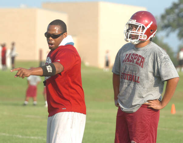 Jasper Coach Ted Williams instructs a player during Monday's opening practice for the Bulldogs. Photo: Jimmy Galvan