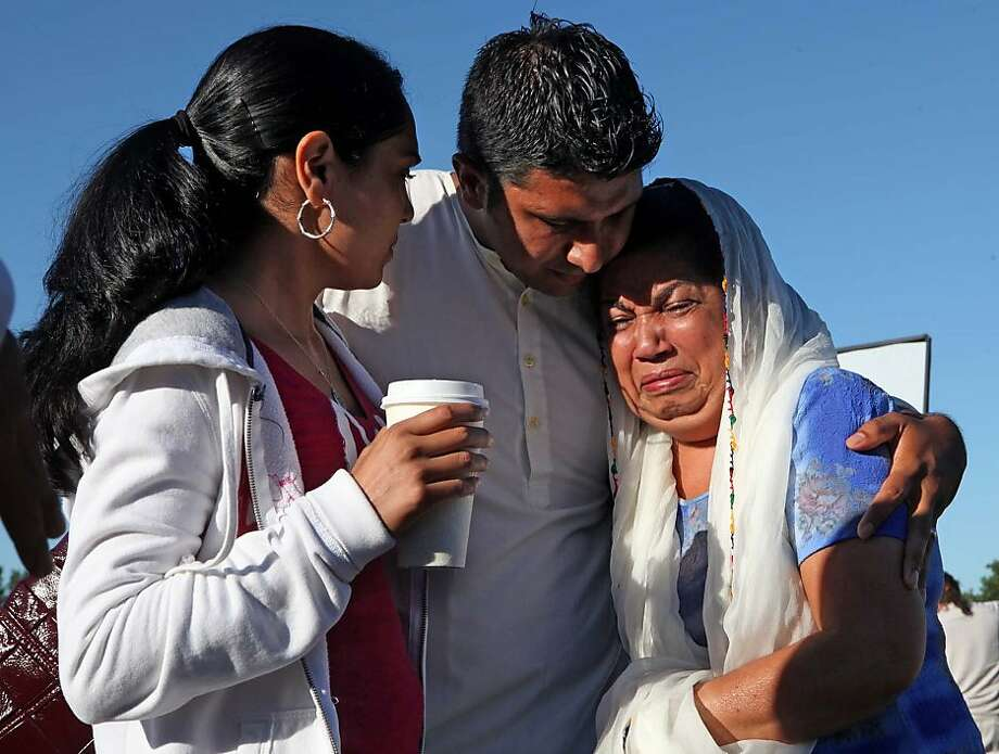 Amardeep Kaleka (center) and two relatives mourn the death of his father, Satwant Singh Kaleka, president of the Oak Creek, Wis., Sikh temple where six people were slain Sunday. Photo: Rick Wood, McClatchy-Tribune News Service