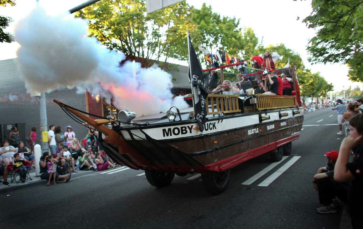 The Seafair Pirates fire their cannon as they drive along Lake City Way in the Grand Parade during Lake City's 70th annual Pioneer Days. The annual festival includes a street fair, salmon bake and parade. Photographed on Saturday, August 4, 2012.