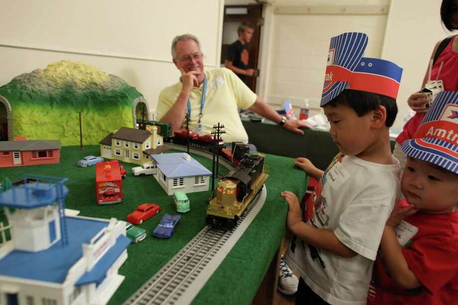 Nathan Park, 5, and his brother Jack Park, 3, check out the Train Collectors model trains display during Lake City's 70th annual Pioneer Days. The annual festival includes a street fair, salmon bake and parade. Photographed on Saturday, August 4, 2012. Photo: JOSHUA TRUJILLO / SEATTLEPI.COM