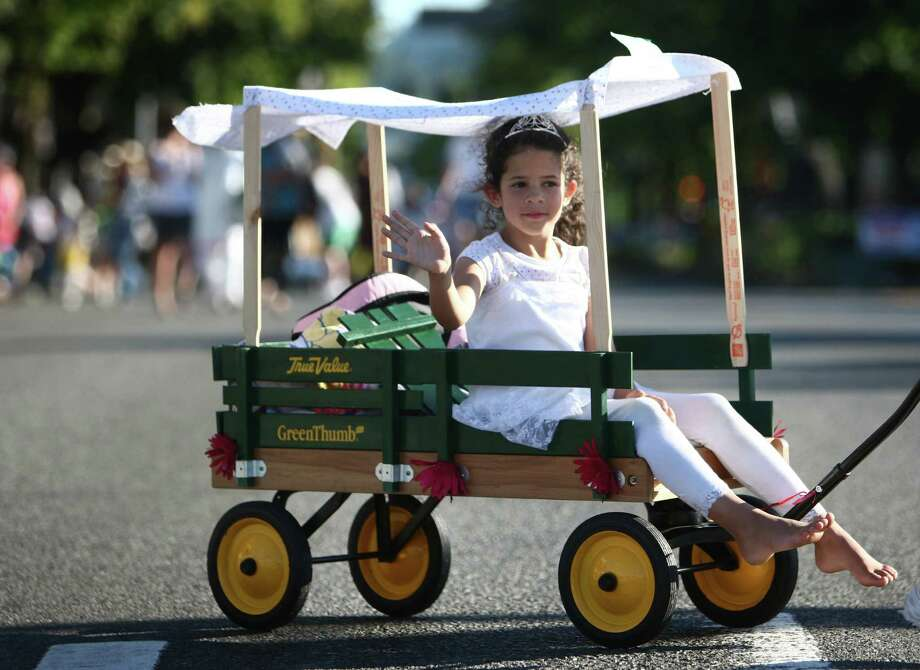 A participant rides in the Lake City Kid's Parade during Lake City's 70th annual Pioneer Days. The annual festival includes a street fair, salmon bake and parade. Photographed on Saturday, August 4, 2012. Photo: JOSHUA TRUJILLO / SEATTLEPI.COM