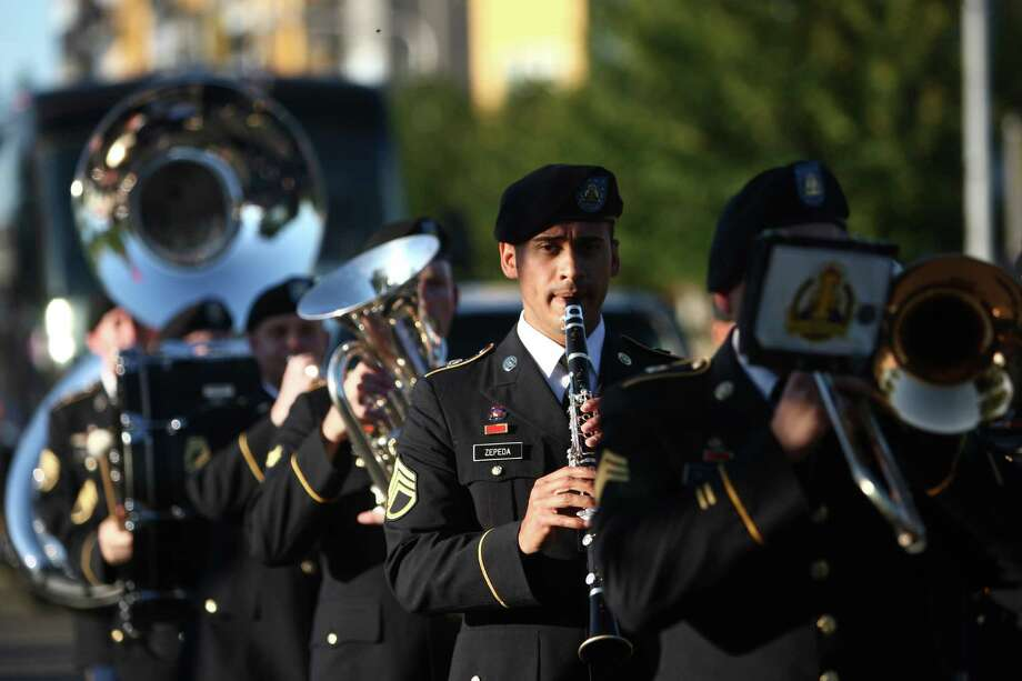 The U.S. Army Band marches during the Grand Parade at Lake City's 70th annual Pioneer Days. The annual festival includes a street fair, salmon bake and parade. Photographed on Saturday, August 4, 2012. Photo: JOSHUA TRUJILLO / SEATTLEPI.COM
