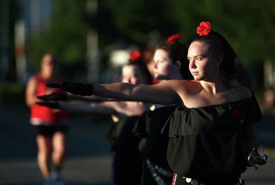 Members of La Senoritas Drill Team march during Lake City's annual Pioneer Days Grand Parade. The annual festival includes a street fair, salmon bake and parade. Photographed on Saturday, August 4, 2012. Photo: JOSHUA TRUJILLO / SEATTLEPI.COM