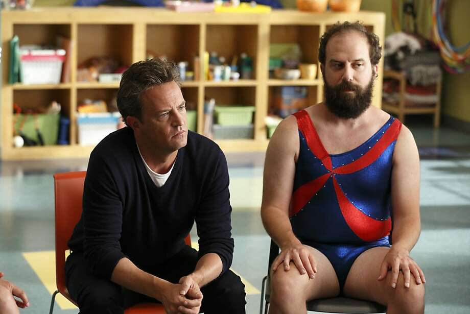 "Matthew Perry (left) and Brett Gelman in a grief-therapy session in the funny ""Go On."" Photo: Justin Lubin, NBC"