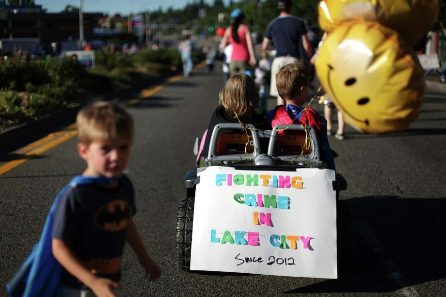 Participants march in the Rotary Kid's Parade during Lake City's 70th annual Pioneer Days. The annual festival includes a street fair, salmon bake and parade. Photographed on Saturday, August 4, 2012. Photo: JOSHUA TRUJILLO / SEATTLEPI.COM