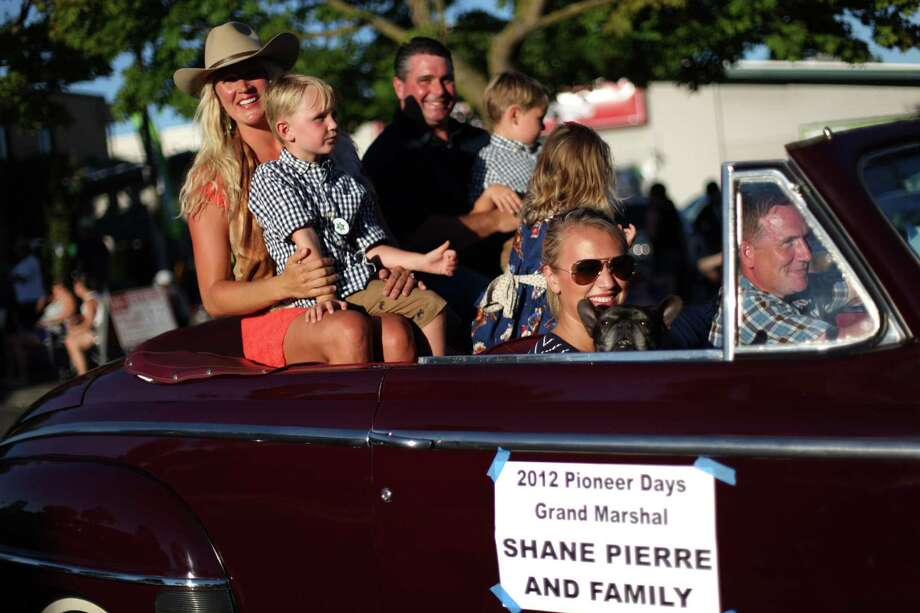 Shane Pierre and his family ride as Grand Marshal of the Bill Pierre Auto Centers Grand Parade during Lake City's 70th annual Pioneer Days. The annual festival includes a street fair, salmon bake and parade. Photographed on Saturday, August 4, 2012. Photo: JOSHUA TRUJILLO / SEATTLEPI.COM