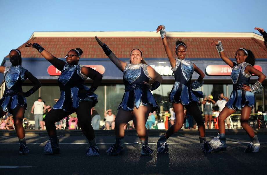 Drill team members perform during Lake City's 70th annual Pioneer Days. The annual festival includes a street fair, salmon bake and parade. Photographed on Saturday, August 4, 2012. Photo: JOSHUA TRUJILLO / SEATTLEPI.COM