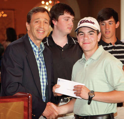 Twenty-six junior golfers from 16 communities throughout the state were awarded scholarships at the Kennedy Center's 21st annual Charity Golf Classic at Shorehaven Country Club in Norwalk. Martin D. Schwartz, left, president and CEO of the Kennedy Center, presented Stephen Galyas of Norwalk, a student at Brien McMahon High School, with one of the scholarships. Norwalk's Jason Cotaling (not pictured) also received a scholarship at the Golf Classic. Selection was based on academic achievement, school and community leadership, and golf proficiency. The event raised nearly $17,000 for programs and services provided by the Kennedy Center for people with disabilities. Photo: Contributed Photo