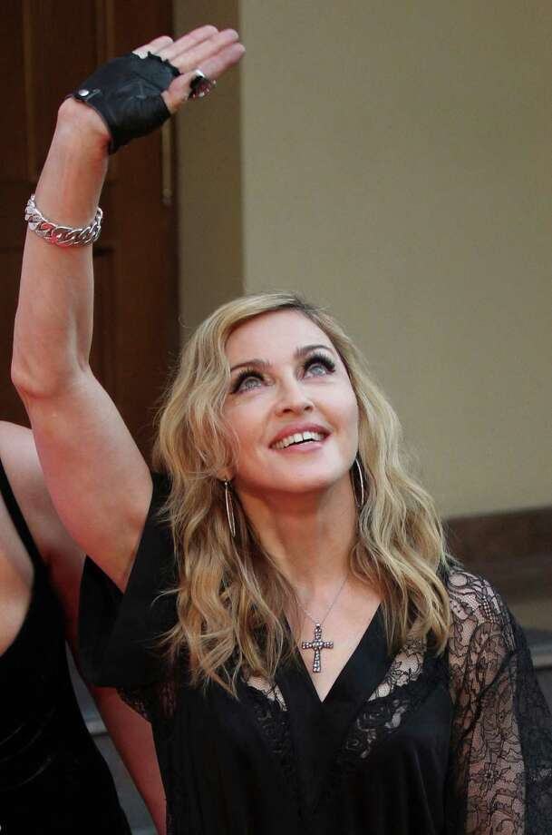 """U.S. singer Madonna greets her fans at the opening of the new fitness club in Moscow, Russia, Monday, Aug. 6, 2012. Madonna has voiced hope that three feminist Russian rockers on trial for performing a """"punk prayer"""" against Vladimir Putin are released soon. The pop star told the AP during her concert tour of Russia that she supports freedom of speech and hopes the judge will show leniency. (AP Photo/Mikhail Metzel) Photo: Mikhail Metzel"""
