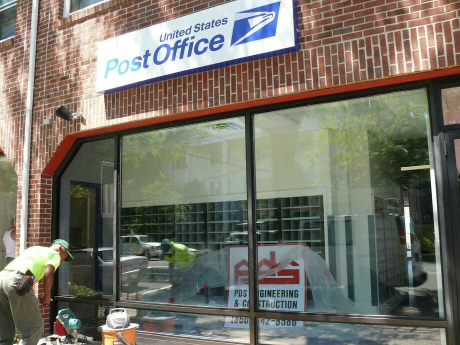 Work continues at 1300 Post Road on the new downtown Post Office facilities, but not date has been set yet for the opening. The original Post Office buiding, at 1262 Post Road, remains open until then. Photo: Genevieve Reilly / Fairfield Citizen