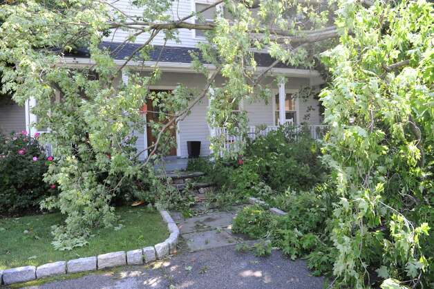 .A tree fell on a house on 12 Wahneta Road in Old Greenwich, Monday, Aug, 6, 2012. A violent storm struck Greenwich Sunday night, knocking down trees that damaged homes in Old Greenwich. Photo: Helen Neafsey / Greenwich Time