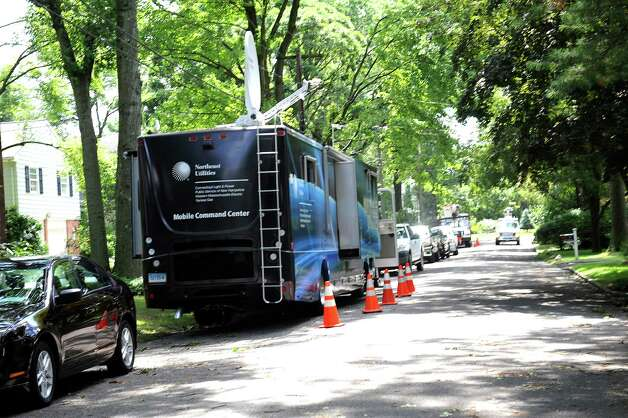 Mobile Command Center of Northeast Utilities parked on Palmer Terrace in Riverside working on a tree that fell on transmission lines Monday Aug., 6, 2012. A violent storm struck Greenwich Sunday night, knocking down trees that damaged homes in Old Greenwich. Photo: Helen Neafsey / Greenwich Time