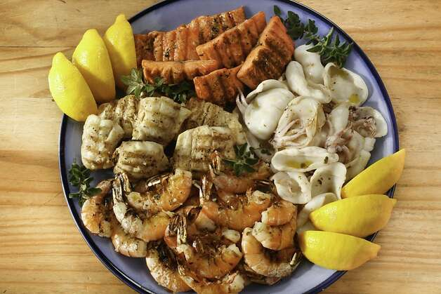Mediterranean Seafood Mixed Grill; styling by Amanda Gold Photo: Craig Lee, Special To The Chronicle