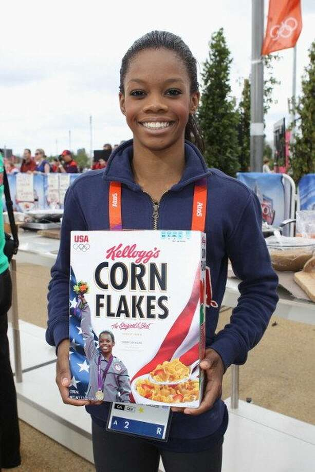 London 2012 Olympic Gymnastics all-around gold medalist Gabby Douglas receives her very own special edition box of Kellogg's Corn Flakes which will hit stores this Fall, on day 7 of the 2012 London Olympic Games on August 3, 2012 in London, England. (Scott Halleran / Getty )