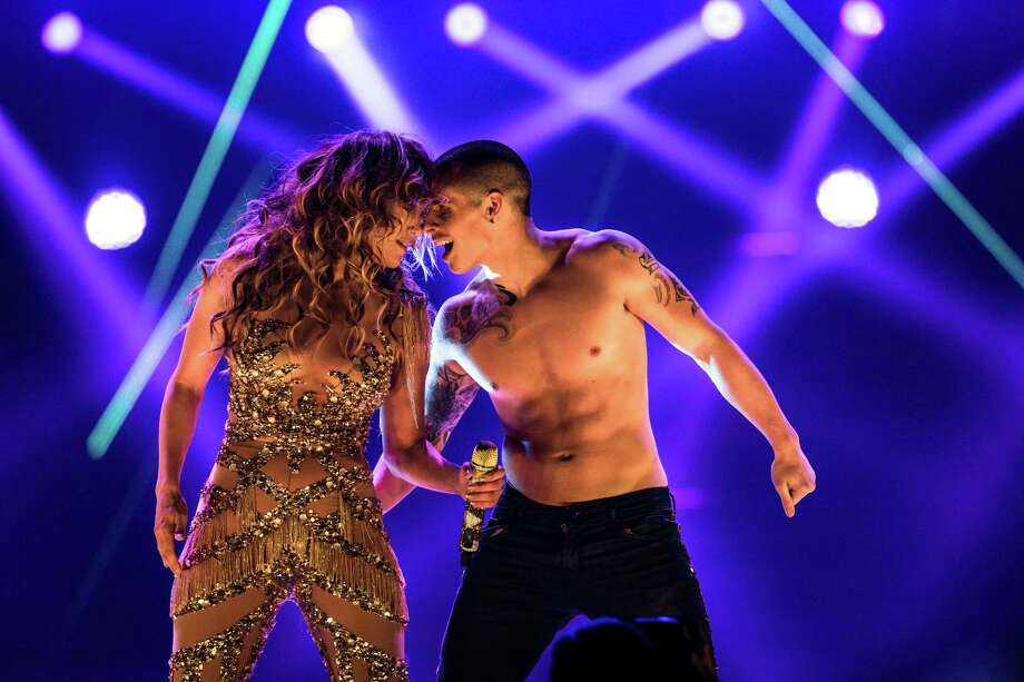 Jennifer Lopez and Casper Smart perform at The Prudential Center in Newark, N.J., July 20, 2012. Lopez's performance on Friday, which included a surprise appearance by Wisin y Yandel, was part of her tour with Enrique Iglesias. Photo: CHAD BATKA, New York Times / NYTNS