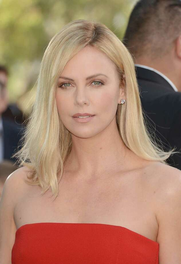 Actress Charlize Theron wore her blond hair shoulder length for quite some time.  Photo: Jason Merritt / 2012 Getty Images