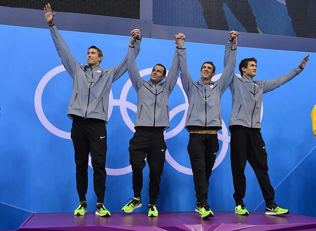 (L-R) US swimmer Matthews Grevers, Brendan Hansen, Michael Phelps and ADrian Nathan pose on the podium after winning gold in the men's 4x100 medley relay final during the swimming event at the London 2012 Olympic Games on August 4, 2012 in London.  AFP PHOTO / FABRICE COFFRINIFABRICE COFFRINI/AFP/GettyImages Photo: Fabrice Coffrini, AFP/Getty Images