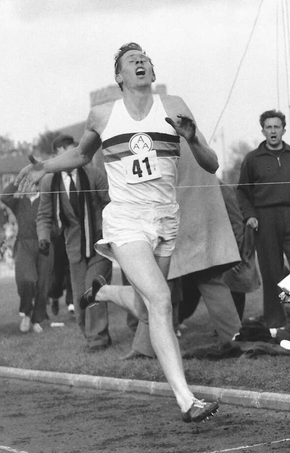 FILE - In this May 6, 1954 file photo, Britain's Roger Bannister hits the tape to break the four-minute mile in Oxford, England. Roger Bannister carried the Olympic torch Tuesday July 10, 2012, across the finish line of the Oxford track where he became the first runner to break the 4-minute barrier for the mile 58 years ago. (AP Photo/File) Photo: Anonymous, Associated Press