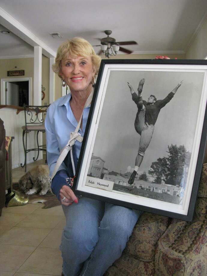 Suzie Heywood of Ingram proudly displays a college football photoÊof her late husband, Ralph A. Heywood, who recently was inducted into the Marine Corps Sports Hall of Fame. He's the only NFL player known to have fought inÊWWII, the Korean War and Vietnam War. Zeke MacCormack / zeke@express-news.net Photo: San Antonio Express-News
