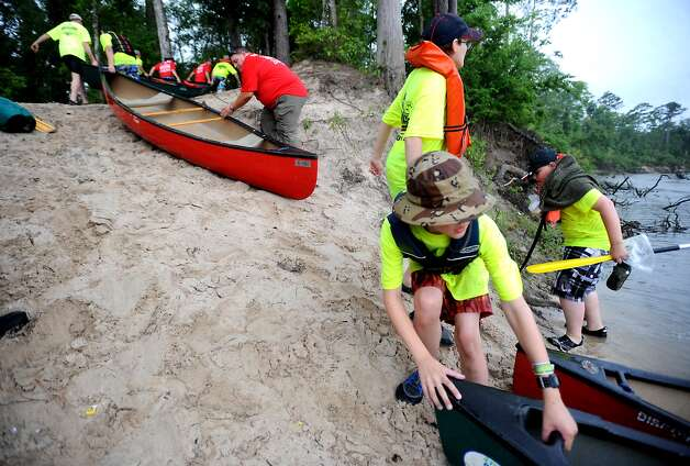 Boy Scouts pull their canoes up the bank during the Boy Scout Camp-O-Ree at Village Creek State Park. Tammy McKinley/ The Enterprise Photo: TAMMY MCKINLEY / Beaumont