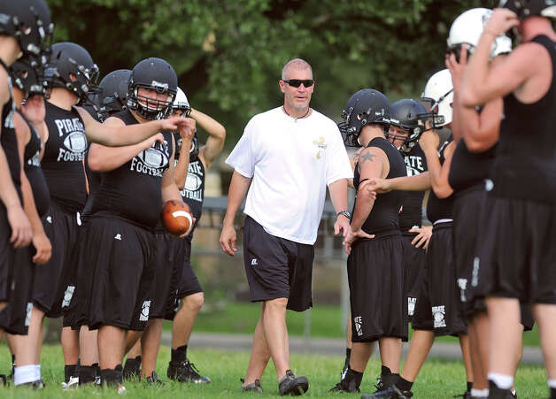 Vidor took to the school's practice field Monday morning to kick start the 2012 season. The Pirates first game will be at home against Santa Fe on August 31. Photo taken Monday, August 06, 2012 Guiseppe Barranco/The Enterprise Photo: Guiseppe Barranco, STAFF PHOTOGRAPHER / The Beaumont Enterprise