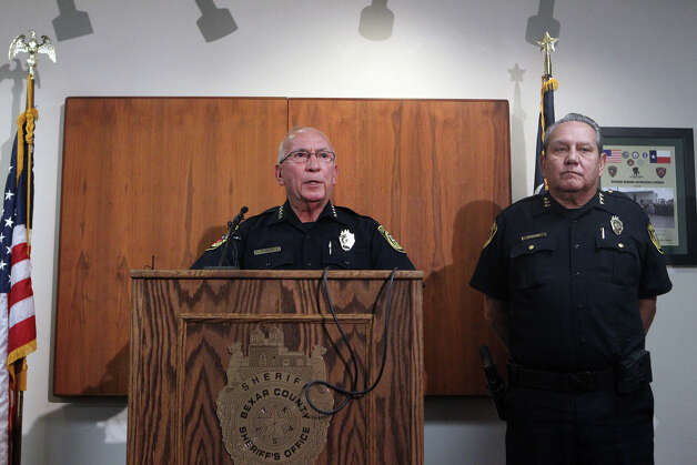 Bexar County Sheriff Amadeo Ortiz (at lectern) speaks to the media Monday August 6, 2012 at the Bexar County Sheriff's Office about two police dogs that died of heat exhaustion while in the care of Sheriff's Deputy Steve Benoy. Ortiz said Benoy forgot about the dogs and that the dogs died of heat exhaustion. Ortiz said measures are being taken to insure this doesn't happen again. Benoy is on administrative leave with pay. The man on the right is Chief Deputy Manuel Longoria. John Davenport/©San Antonio Express-News Photo: John Davenport/© San Antonio Ex, San Antonio Express-News / John Davenport/©San Antonio Exp
