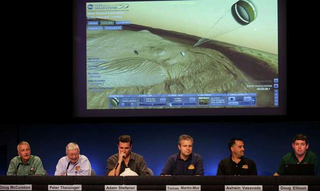 Scientists comment on a parachute deployment of the Curiosity Mars Rover during a media briefing of the Mars Science Laboratory, MSL science overview news briefing at NASA's Jet Propulsion Laboratory, JPL, in Pasadena, Calif., Thursday, Aug. 2, 2012. From left: Doug McCuistion, Mars Exploration Program director, NASA Headquarters, Peter Theisinger, MSL project manger, NASA JPL, Pasadena, Adam Steltzner, MSL entry, descent and landing phase lead, JPL, Thomas Martin-Mur, MSL navigator team chief, JPL, Ashwin Vasavada, MSL deputy project scientist, JPL, Doug Ellison, visualization producer, JPL. (AP Photo/Damian Dovarganes) Photo: Damian Dovarganes, Associated Press / AP