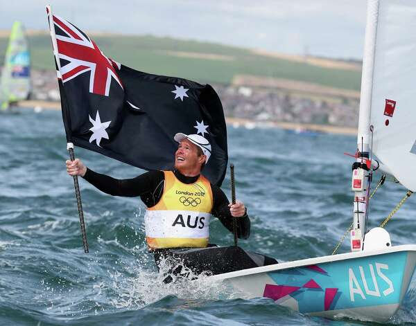 WEYMOUTH, ENGLAND - AUGUST 06:  Tom Slingsby of Australia celebrates winning gold in the Men's Laser Sailing on Day 10 of the London 2012 Olympic Games at the Weymouth & Portland Venue at Weymouth Harbour on August 6, 2012 in Weymouth, England. Photo: Clive Mason, Getty Images / 2012 Getty Images