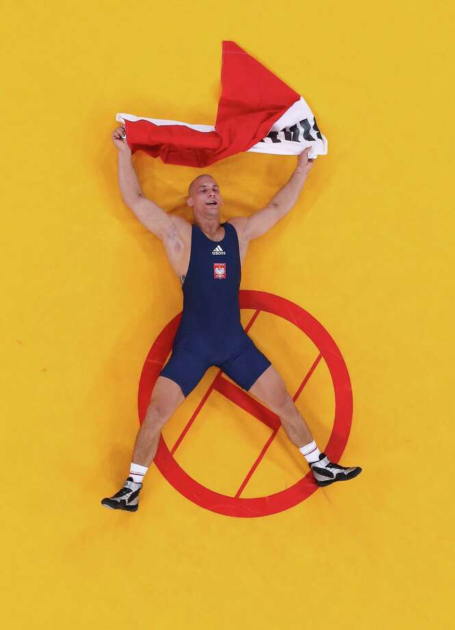 LONDON, ENGLAND - AUGUST 06:  Damian Janikowski of Poland celebrates beating Melonin Noumonvi of France in their Men's Greco-Roman 84 kg Bronze Medal bout on Day 10 of the London 2012 Olympic Games at ExCeL on August 6, 2012 in London, England. Photo: Ian Walton, Getty Images / 2012 Getty Images