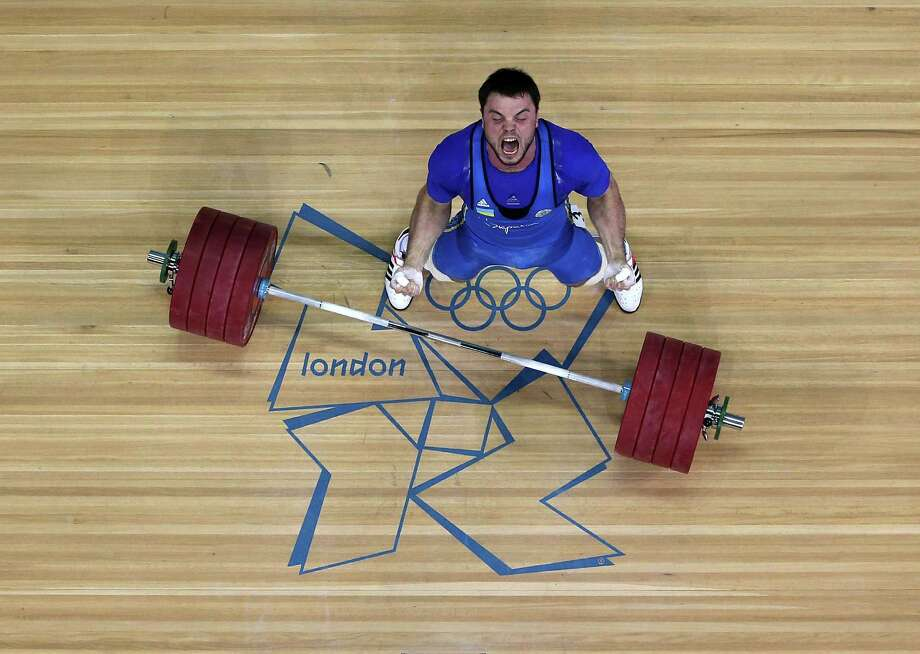 LONDON, ENGLAND - AUGUST 06:  Oleksiy Torokhtiy of Ukraine celebrates after winning the gold medal in the Men's 105kg Weightlifting on Day 10 of the London 2012 Olympic Games at ExCeL on August 6, 2012 in London, England. Photo: Richard Heathcote, Getty Images / 2012 Getty Images
