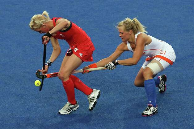 LONDON, ENGLAND - AUGUST 06:  Alex Danson of Great Britain is tackled by Sophie Polkamp of the Netherlands during the Women's Hockey match between Great Britain and the Netherlands on Day 10 of the London 2012 Olympic Games at Riverbank Arena Hockey Centre on August 6, 2012 in London, England. Photo: Quinn Rooney, Getty Images / 2012 Getty Images