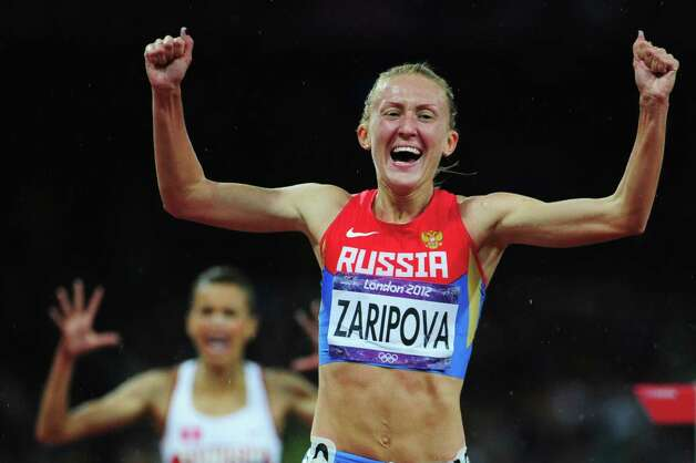 LONDON, ENGLAND - AUGUST 06:  Yuliya Zaripova of Russia celebrates as she crosses the finish line to win the gold medal in the Women's 3000m Steeplechase final on Day 10 of the London 2012 Olympic Games at the Olympic Stadium on August 6, 2012 in London, England. Photo: Stu Forster, Getty Images / 2012 Getty Images