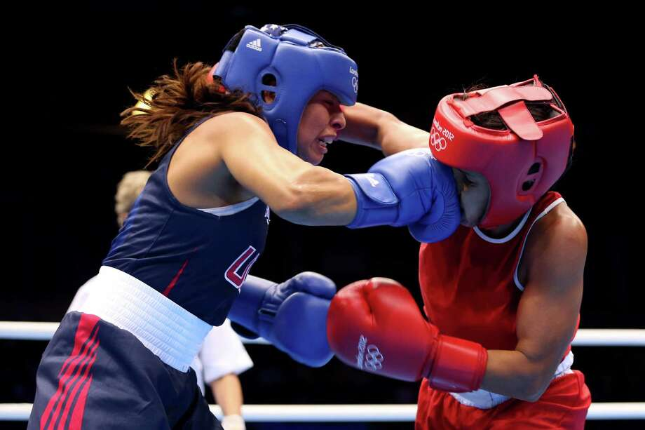 LONDON, ENGLAND - AUGUST 06:  Marlen Esparza of the United States competes against Karlha Magliocco of Venezuela during the Women's Fly (51kg) Boxing Quarterfinals on Day 10 of the London 2012 Olympic Games at ExCeL on August 6, 2012 in London, England. Photo: Scott Heavey, Getty Images / 2012 Getty Images
