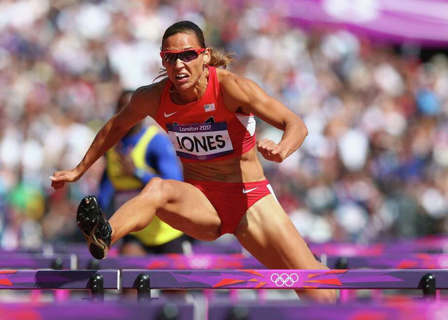 LONDON, ENGLAND - AUGUST 06:  Lolo Jones of the United States competes in the Women's 100m Hurdles heat on Day 10 of the London 2012 Olympic Games at the Olympic Stadium on August 6, 2012 in London, England. Photo: Michael Steele, Getty Images / 2012 Getty Images