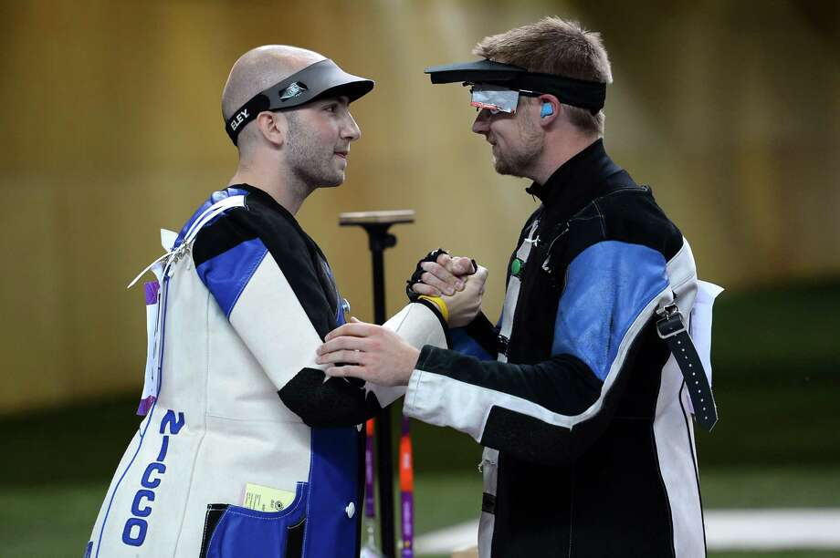 LONDON, ENGLAND - AUGUST 06:  Niccolo Campriani (L) of Italy celebrates winning the Gold Medal with Silver medallist Matthew Emmons of the United States in the Men's 50m Rifle 3 Positions Shooting Final on Day 10 of the London 2012 Olympic Games at the Royal Artillery Barracks on August 6, 2012 in London, England. Photo: Lars Baron, Getty Images / 2012 Getty Images