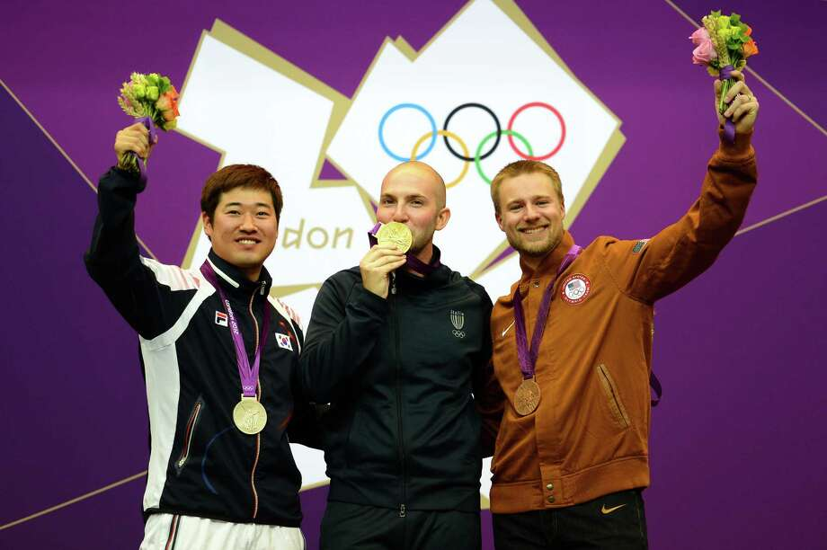 LONDON, ENGLAND - AUGUST 06:  (L-R) Silver medallist Jonghyun Kim of Korea, Gold medallist Niccolo Campriani of Italy, and Bronze Medallist Matthew Emmons of the United States during the medal ceremony for the Men's 50m Rifle 3 Positions Shooting Final on Day 10 of the London 2012 Olympic Games at the Royal Artillery Barracks on August 6, 2012 in London, England. Photo: Lars Baron, Getty Images / 2012 Getty Images
