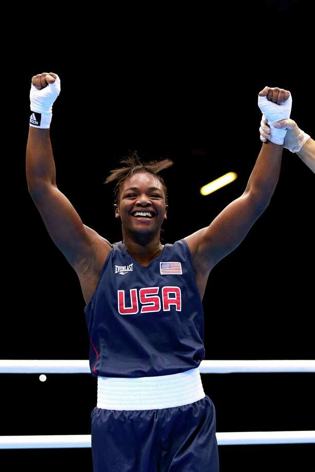 LONDON, ENGLAND - AUGUST 06:  Claressa Shields (Blue) of the United States celebrates after defeating Anna Laurell of Sweden in the Women's Middle (75kg) Boxing Quarterfinals on Day 10 of the London 2012 Olympic Games at ExCeL on August 6, 2012 in London, England. Photo: Scott Heavey, Getty Images / 2012 Getty Images