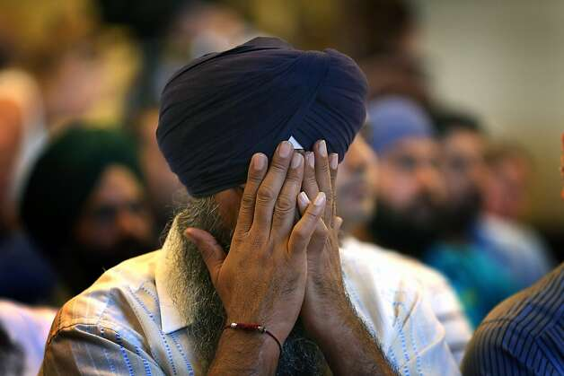 A member of the Milwaukee-area Sikh community weeps as he listens to information about the shooting. Photo: Scott Olson, Getty Images