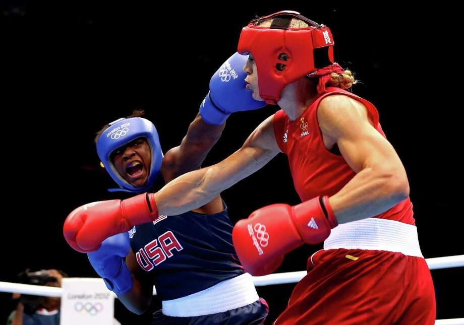 LONDON, ENGLAND - AUGUST 06:  Claressa Shields (Blue) of the United States competes against Anna Laurell of Sweden (Red) during the Women's Middle (75kg) Boxing Quarterfinals on Day 10 of the London 2012 Olympic Games at ExCeL on August 6, 2012 in London, England. Photo: Scott Heavey, Getty Images / 2012 Getty Images