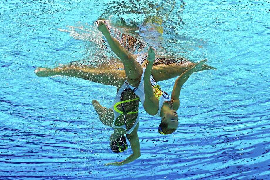 LONDON, ENGLAND - AUGUST 06:  Mary Killman and Mariya Koroleva of the United States compete in the Women's Duets Synchronised Swimming Free Routine Preliminary on Day 10 of the London 2012 Olympic Games at the Aquatics Centre on August 6, 2012 in London, England. Photo: Clive Rose, Getty Images / 2012 Getty Images