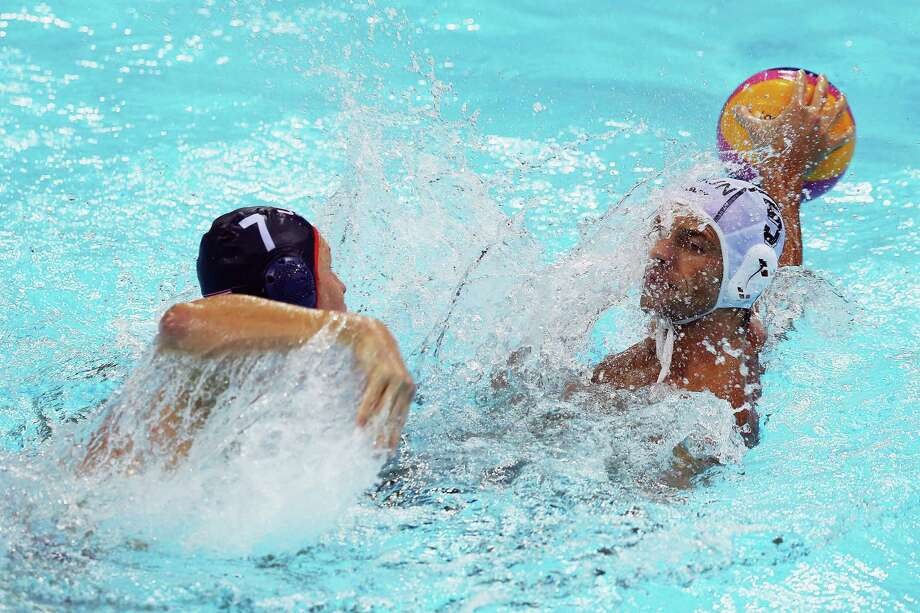 LONDON, ENGLAND - AUGUST 06: Tamas Kasas of Hungary looks to pass the ball past Layne Beaubien of The United States of America in the Preliminary Round Group B match between Hungary and The United States of America on Day 10 of the London 2012 Olympic Games at Water Polo Arena on August 6, 2012 in London, England. Photo: Hannah Johnston, Getty Images / 2012 Getty Images