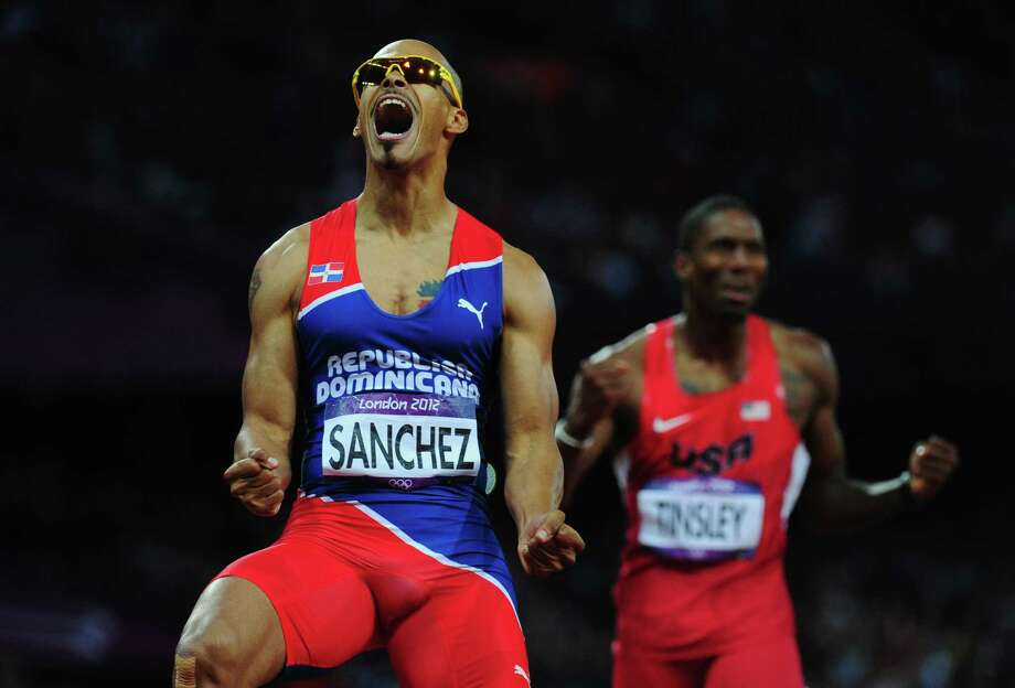 LONDON, ENGLAND - AUGUST 06:  Felix Sanchez of Dominican Republic celebrates as he crosses the finish line to win the gold medal ahead of Michael Tinsley of the United States in the Men's 400m Hurdles final on Day 10 of the London 2012 Olympic Games at the Olympic Stadium on August 6, 2012 in London, England. Photo: Stu Forster, Getty Images / 2012 Getty Images