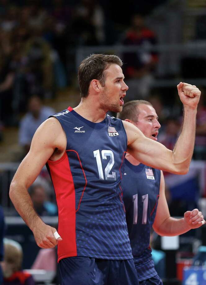 LONDON, ENGLAND - AUGUST 06:  Russell Holmes #12 and Brian Thornton #11 of United States celebrate a point in the third set against Tunisia during Men's Volleyball on Day 10 of the London 2012 Olympic Games at Earls Court on August 6, 2012 in London, England. Photo: Elsa, Getty Images / 2012 Getty Images