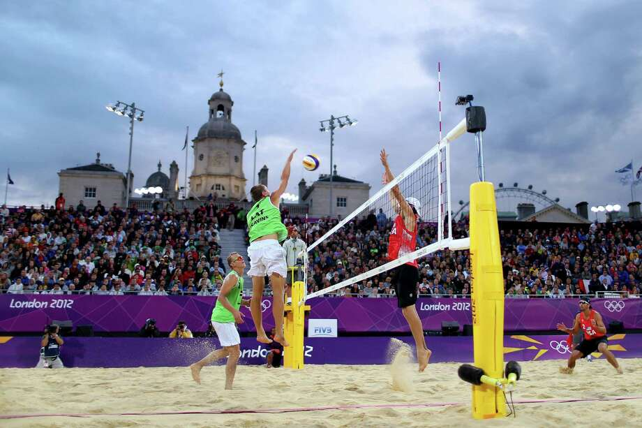 LONDON, ENGLAND - AUGUST 06:  (L-R) Janis Smedins and Martins Plavins of Latvia return against Jacob Gibb and Sean Rosenthal of the United States during the Men's Beach Volleyball quarterfinal match between the United States and Latvia on Day 10 of the London 2012 Olympic Games at Horse Guards Parade August 6, 2012 in London, England. Photo: Ryan Pierse, Getty Images / 2012 Getty Images
