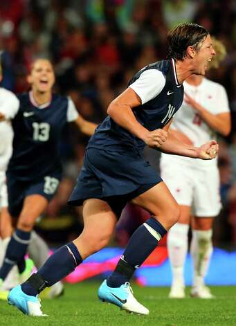MANCHESTER, ENGLAND - AUGUST 06: Abby Wambach of the United States celebrates after she converted the penalty during the Women's Football Semi Final match between Canada and USA, on Day 10 of the London 2012 Olympic Games at Old Trafford on August 6, 2012 in Manchester, England. Photo: Stanley Chou, Getty Images / 2012 Getty Images